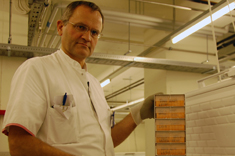 Professor Borge Nordestgaard with tower of blood samples at Copenhagen University Hospital