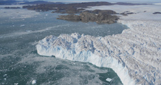 The calving front of the second most southerly tributary of the Upernavik Icestream. The glacier front in the center of the picture rises approximately 40 m above sea level. Credit: Niels J. Korsgaard, Natural History Museum of Denmark.