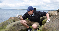 PhD student Philip Francis Thomsen is sampling seawater for DNA analyses. The researchers found DNA from both fish and whales in the water. Photo: Jos Kielgast.