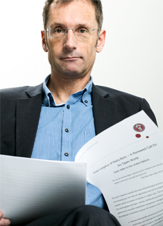 Professor Ole Waever holding the conference participants' new open letter to the world.