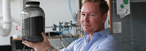 Associate Professor Kasper Nørgaard with the graphite that starts it all for graphene