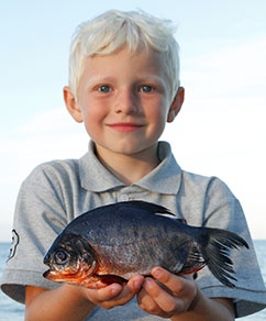 Danish boy Malthe with Pacu. Photo: Henrik Carl
