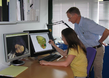 Resaerchers analyzing CT scans of Inca mummies.