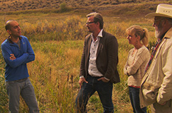 Shane Doyle (left) telling Eske Willerslev, Sarah Anzick and Larry Lahren about the history of the land. (Photo: Linus Mørk).